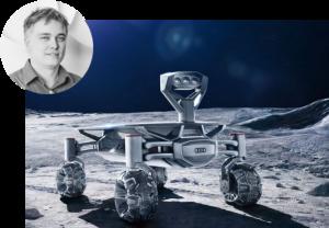 """Jürgen Brandner, CTO der PT-Scientists, mit dem """"Audi Lunar Quattro"""" Moon-Rover, der Ende 2017 unbemannt auf dem Mond landen wird."""